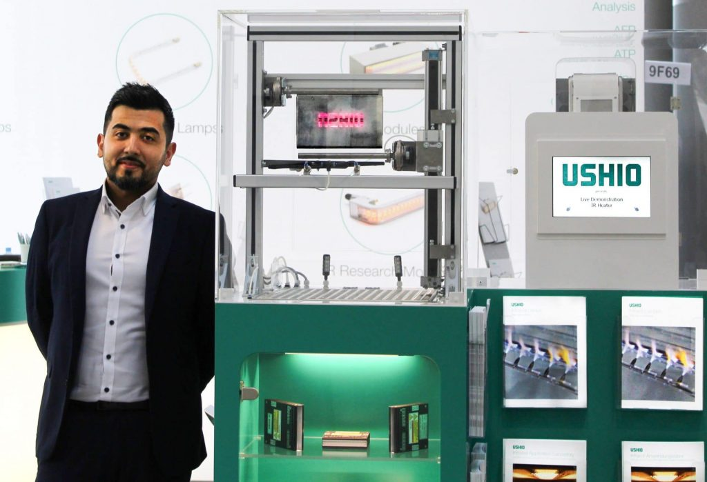 Mr Esmat Jawad stands beside the active USHIO Excimer Demonstrator